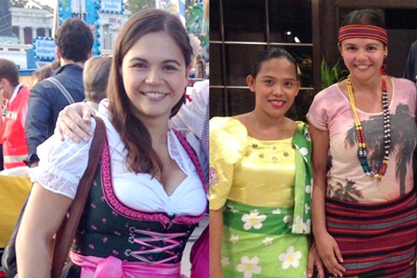 Eine Frau im Dirndl und zwei Frauen in philippinischer Tracht